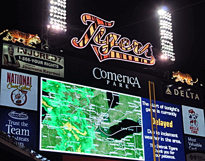 A local weather map showing the incoming inclement weather is displayed on the scoreboard at Comerica Park. (US Presswire)