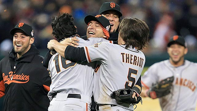 Newcomer Marco Scutaro (center) gives the Giants a lift, and Ryan Theriot thrives in a new role. (Getty Images)