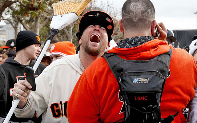 Fans carry reminders of the Giants' World Series sweep of the Tigers during the parade. (US Presswire)