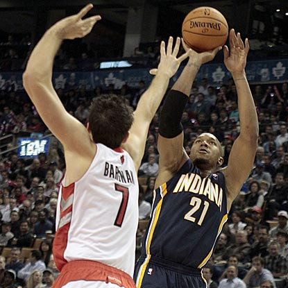 David West, shown here shooting over Andrea Bargnani, scores a game-high 25 points for the victorious Pacers.  (US Presswire)