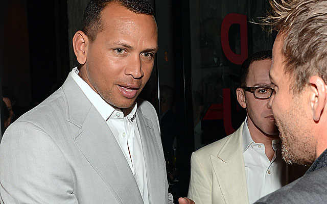 A-Rod, here attending a charity dinner in Miami, could miss up to six months from surgery. (Getty Images)