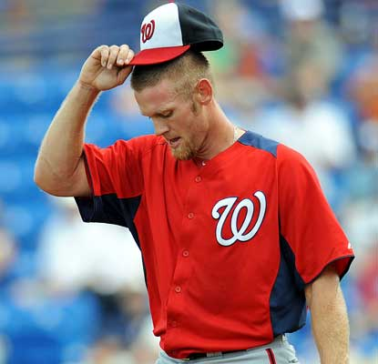 Stephen Strasburg pitches in his first game since September 7 and gives up a homer in the first inning. (USATSI)