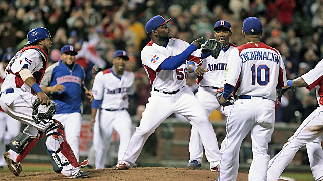 Dominican Republic pitcher Fernando Rodney celebrates with teammates after the win against Netherlands. (USATSI)
