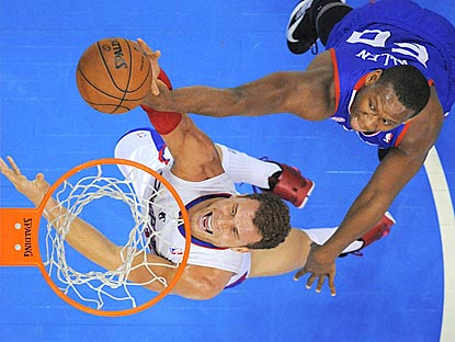 Blake Griffin puts up a shot as Sixers center Lavoy Allen defends during the first half.  (AP)