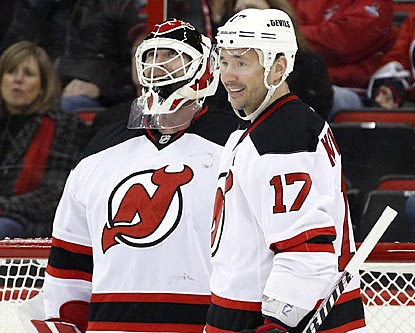 A bemused Martin Brodeur is congratulated by Ilya Kovalchuk (17) after getting credited with his third NHL goal.  (USATSI)