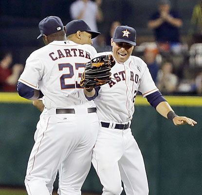 Rick Ankiel (right) helps the Astros prevail in their AL debut with a pinch-hit three-run homer in the sixth. (AP)