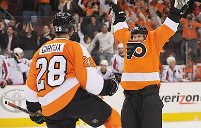Claude Giroux is the first to congratulate Kimmo Timonen after his goal ties the game in the final seconds of regulation.  (USATSI)