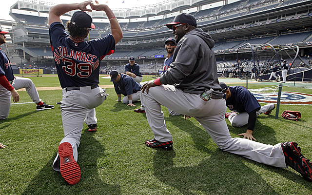 Ortiz (right) stretches out with his fellow Red Sox before Monday's game at Yankee Stadium. (Getty Images)