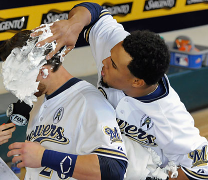 Carlos Gomez (right) gives catcher Jonathan Lucroy a little reward for playing hero for the Brewers. (USATSI)