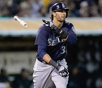 Michael Morse admires his opposite-field home run in the third inning, a three-run shot that gives Seattle a 3-1 lead.  (Getty Images)