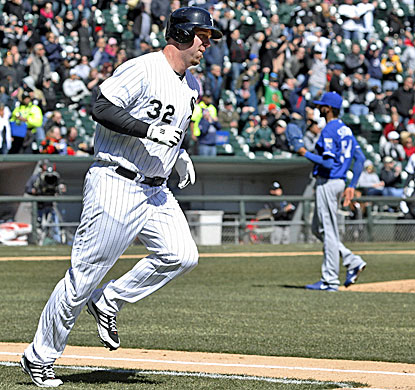 Chicago's Adam Dunn rounds the bases after hitting a home run off Royals starter Ervin Santana (right) in the second inning. (AP)
