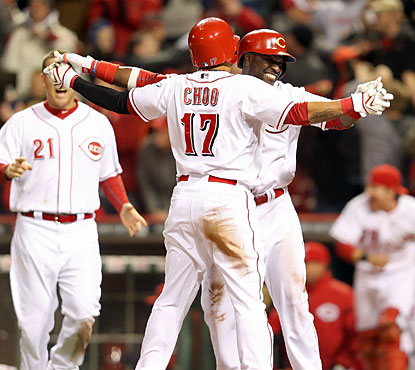 Brandon Phillips, who provides a three-run blast, celebrates with Shin-Soo Choo, who represents the winning run. (Getty Images)