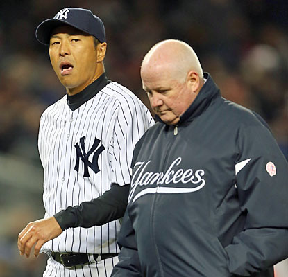 Hiroki Kuroda's night ends in the second inning after he bruises the middle finger on his pitching hand. (Getty Images)