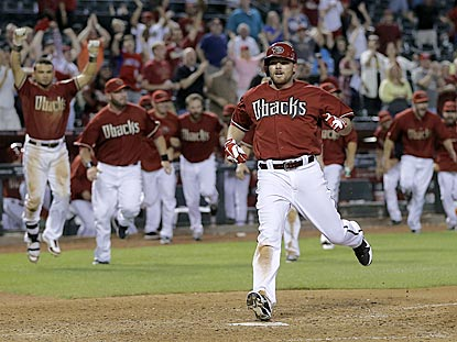 Five hours and 32 minutes after it begins, Jason Kubel ends the game by scoring on Cliff Pennington's 16th-inning single.  (AP)