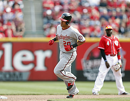 Ian Desmond rounds the bases after blasting a solo home ruin in the 11th inning against the Reds. (Getty Images)