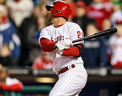 Pinch-hitter Kevin Frandsen hits a bases-clearing, three-run double with two outs in the ninth for Philly. (Getty Images)