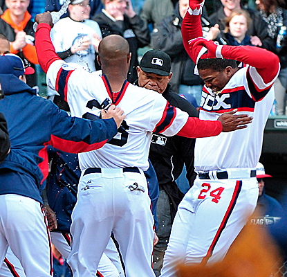 Dayan Viciedo is mobbed at home plate after connecting for a walk-off home run in the 10th inning.  (USATSI)