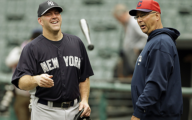 Kevin Youkilis chats with Francona, his old skipper, who got lost on his way to the ball park. (Getty Images)