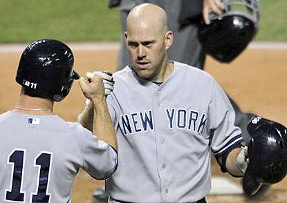 Brett Gardner (11) congratulates Kevin Youkilis on his two-run blast in the sixth inning, which boosts New York's lead to 9-0.  (USATSI)
