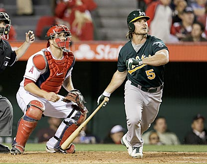 John Jaso, along with Angels catcher Chris Iannetta, follows the flight of his deciding pinch-hit smash in the seventh inning.  (AP)