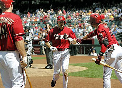 A.J. Pollock (center) is greeted by Martin Prado after hitting one of his home runs. (AP)