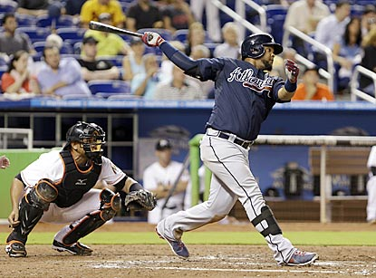 Atlanta's Juan Francisco connects for a tape-measure home run during the fifth inning.  (AP)