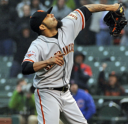 Sergio Romo gets out of a tight jam in the ninth to preserve the Giants' victory over the Cubs.  (USATSI)