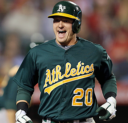 Josh Donaldson is all smiles after hitting a huge two-run homer to springboard the A's.  (Getty Images)