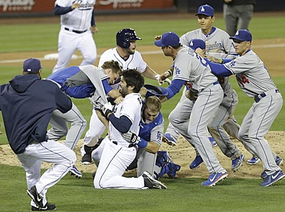 Carlos Quentin and Zack Greinke tangle while their teammates move in to get involved. Quentin and Matt Kemp are ejected.  (AP)