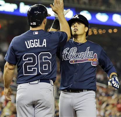 Ramiro Pena greets Dan Uggla after hitting his decisive two-run homer in the 10th inning for the red-hot Braves.  (AP)