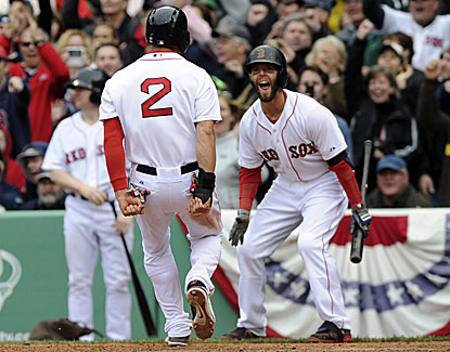 Dustin Pedroia welcomes Jacoby Ellsbury home with the winning run as the Red Sox edge Tampa Bay 2-1. (USATSI)