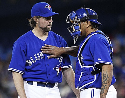R.A. Dickey picks up his first win with the Toronto Blue Jays, holding Kansas City to one run in 6 2/3 innings. (USATSI)