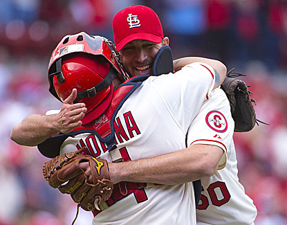 Adam Wainwright tosses a four-hit shutout, retiring the first 10 Milwaukee hitters in an 8-0 victory. (USATSI)