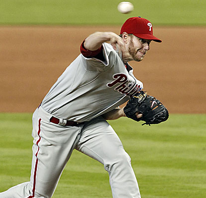 Philly starter Roy Halladay (1-2) allows five hits, walks one and lowers his ERA from 14.73 to 7.63. (USATSI)