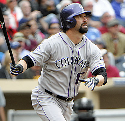 Rockies stalwart Todd Helton hits a pinch-hit, two-run homer in the seventh inning to lift Colorado. (USATSI)