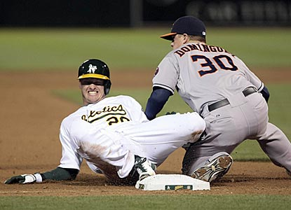 Oakland's Josh Donaldson beats Matt Dominguez's tag and slides in with the game-deciding triple in the eighth inning.  (USATSI)