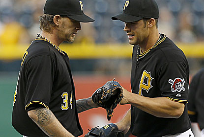 A.J. Burnett (left) has his no-hitter broken up with two outs in the seventh in an outing in which he records his 2,000th K. (AP)