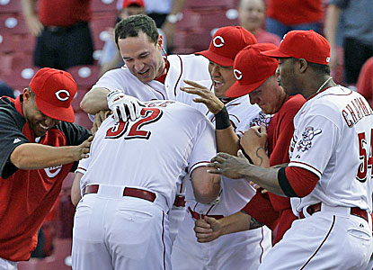 Jay Bruce is mobbed by teammates after driving in the winning run in the bottom of the ninth inning. (AP)