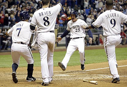 Milwaukee pinch-runner Josh Prince gets a warm welcome while scoring the winning run on Blake Lalli's single in the ninth.  (AP)