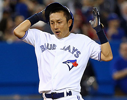 Munenori Kawasaki comes around to score on Rajai Davis' RBI double in the fifth in Toronto's 3-1 win over Chicago. (Getty Images)