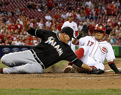 Cincinnati's Shin-Soo Choo slides in safely under the tag of Marlins starter Jose Fernandez. (USATSI)