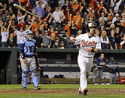 Baltimore's Matt Wieters flips the bat and watches his walk-off grand slam leave the yard in a 10-6 win over Tampa Bay. (AP)
