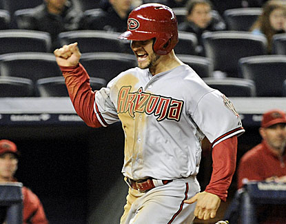 Cody Ross scores on Eric Chavez's three-run double after hitting  the go-ahead single in the 12th against the Yankees. (AP)