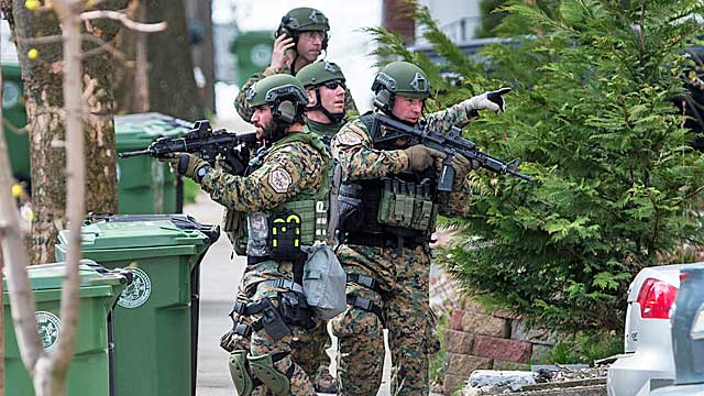 SWAT teams search homes in Watertown for the second suspect in the Boston Marathon bombings. (Getty Images)