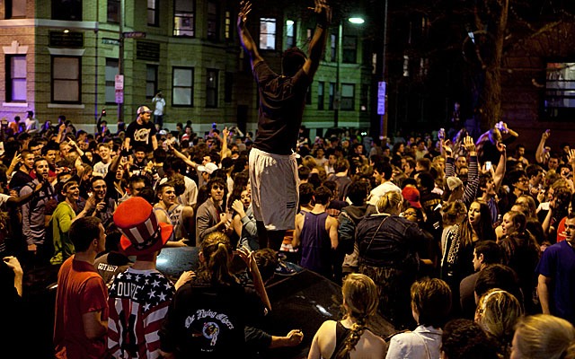 Hundreds poured into the streets near Fenway Park after the Boston bombing suspect's capture. (Getty Images)