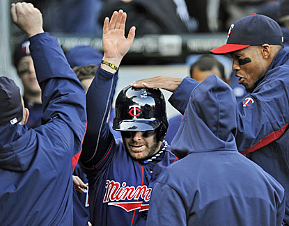 Ryan Doumit doubles in the 10th and comes around to score the winning run on an error for the Twins. (AP)