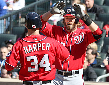 Bryce Harper slugs two home runs, including a go-ahead blast in the eighth, to lead the Nats to a 7-6 win over the Mets. (AP)