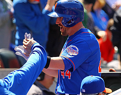 New York's John Buck gives the Mets offense a boost, hitting his seventh home run of the season. (Getty Images)