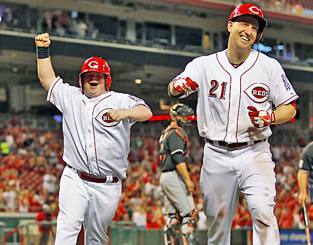 Teddy Kremer (left) celebrates after Todd Frazier hits his promised home run. (Jeff Swinger/Cincinnati Enquirer)