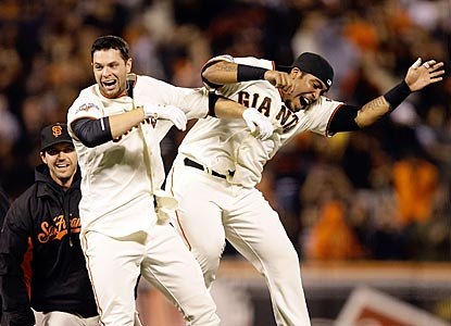 Brandon Belt (left) and Hector Sanchez celebrate after Belt delivers a walk-off single in the ninth inning.  (AP)